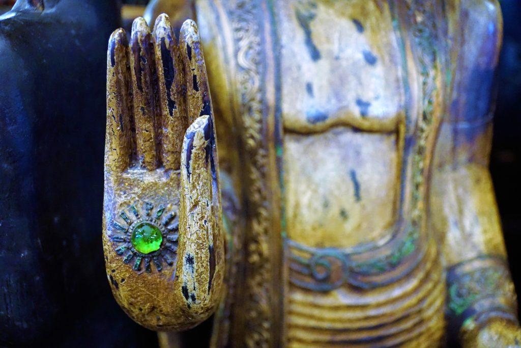 Buddha Hand mit Sonne
